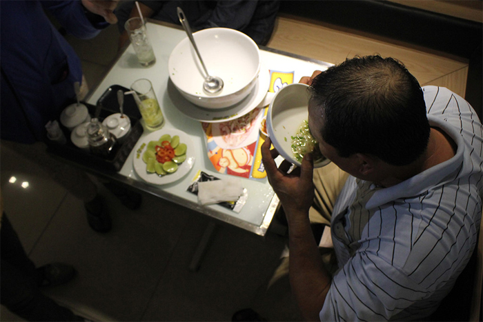 A man is eating the noodles soup in Saigon, Vietnam