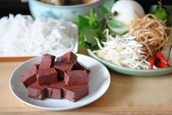 Cubes of congealed pig blood to boiling - Bun Bo Hue