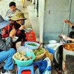 People enjoy Bun Bo Hue as the breakfast by Dong Ba Market