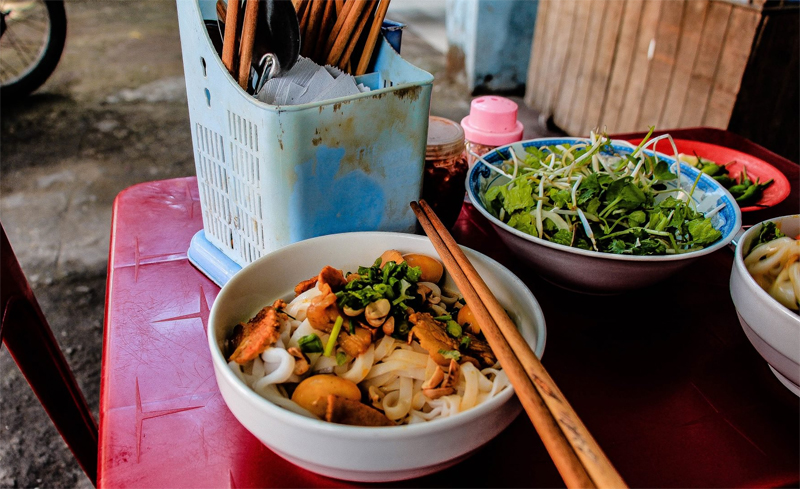 Try using chopsticks while eating Vietnamese streed food